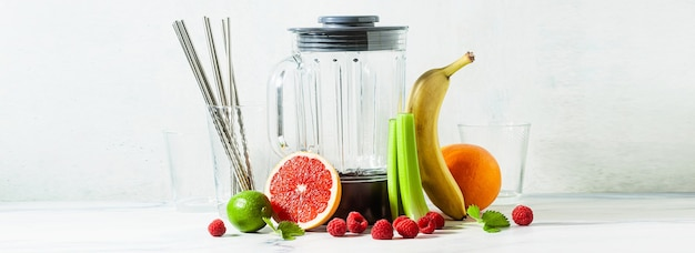 Banner of empty glass smoothie blender bowl and ingredients on the table. not disposable metal tubes. healthly food.
