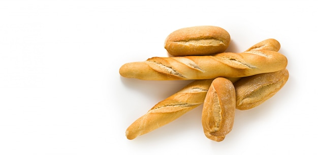 Banner of fresh white bread baguette and bun isolated on white with seeds