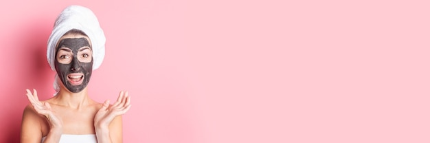 Banner of happy woman with a black face mask on a pink background