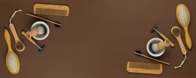 A banner of shaving and shower accessories on a brown background. men's accessories for appearance care. flat lay.