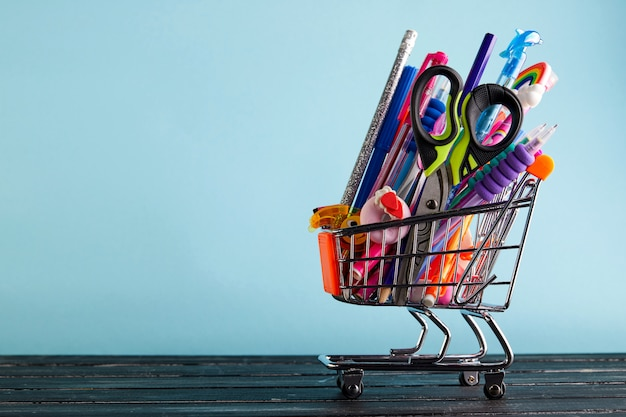 Banner of shopping cart with school supply o