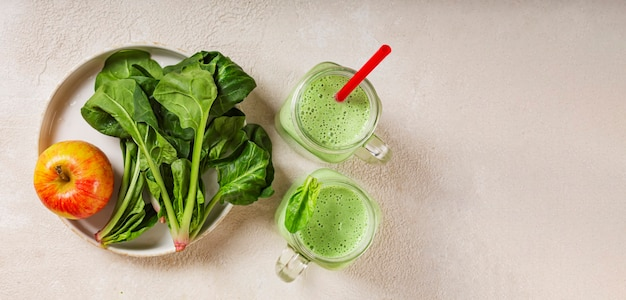 Banner spinach and yogurt smoothie with apple juicy spinach leaves and ripe red apple healthy eating
