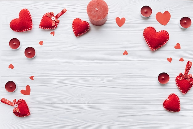 Banner for valentine day with decorative hearts, candles and gifts