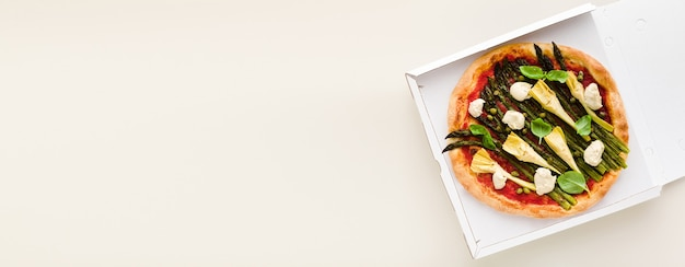 Banner of vegan pizza asparagus in a box for delivery, advertising or menu