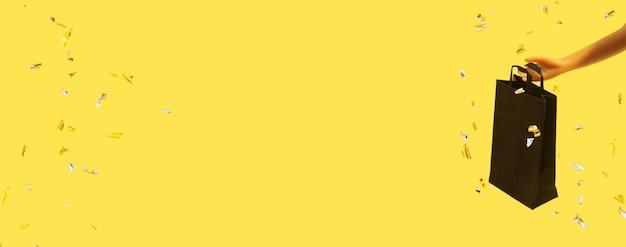 노란색 배경에 스파클이 있는 인형 손에 검은 금요일 판매에 검은색 쇼핑백이 있는 배너