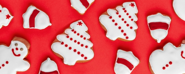 Banner with cookies shaped snowman, bell ring and christmas tree on a bright background.
