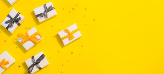 Banner with festive boxes and confetti bright festive background