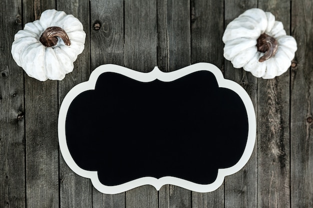 Banner with white pumpkins on a wooden background