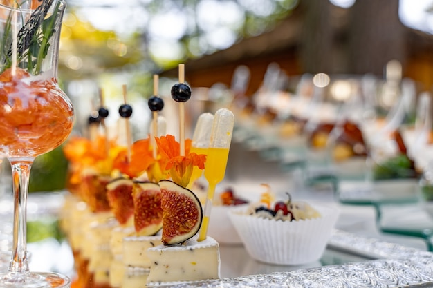 Banquet event. table with glasses, snacks and appetizers. celebrating event. blurred background.