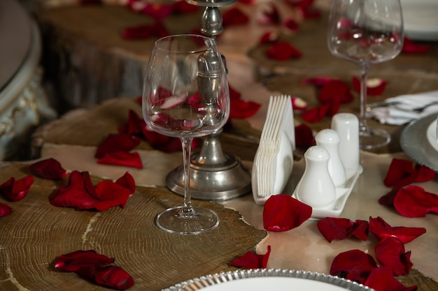 Banquet table decorated with rose petals. restaurant table for a wedding.