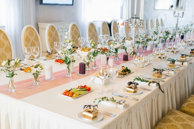 Banquet wedding table in a restaurant or cafe in beige and brown colors. serving