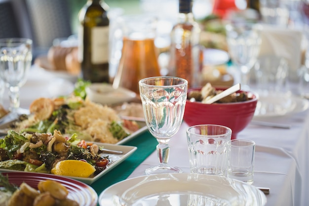 Banquet wedding table setting on evening reception waiting guests