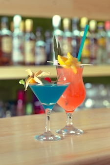 Bar counter cocktails drinks selection multicolored summer drinks