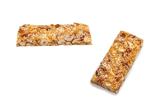 Bar with mix of nuts isolated on a white background. top view.