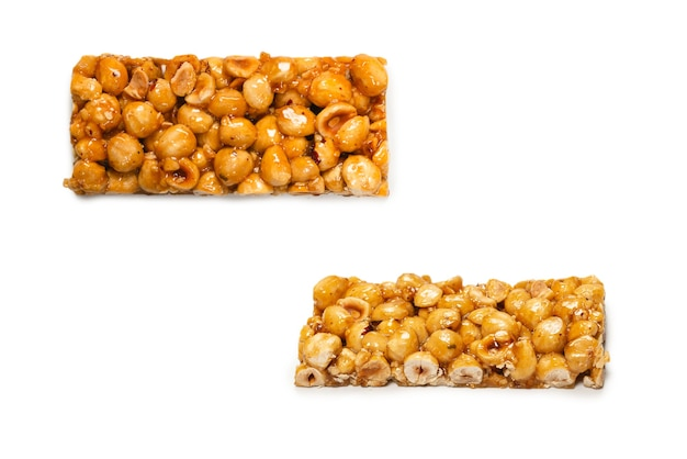Bar with nuts isolated on a white background. hazelnut bar. top view.
