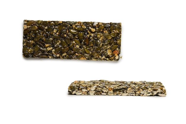 Bar with nuts isolated on a white background. pumpkin seeds bar. top view.
