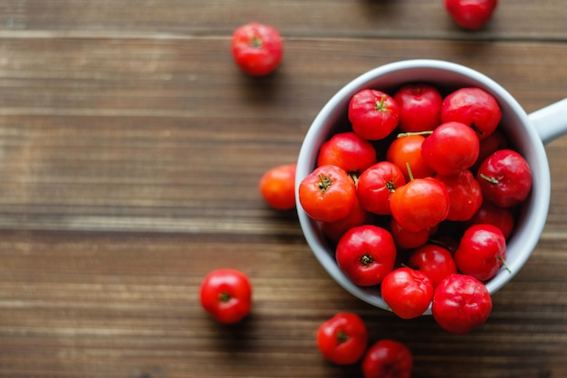 Barbados cherry on wood table background