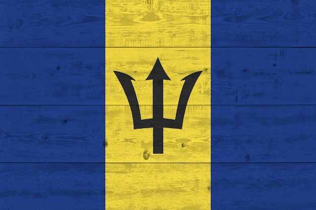 Barbados flag painted on old wood plank
