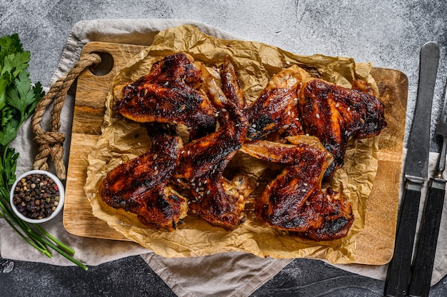 Barbecue chicken wings. farm organic meat. top view. gray background