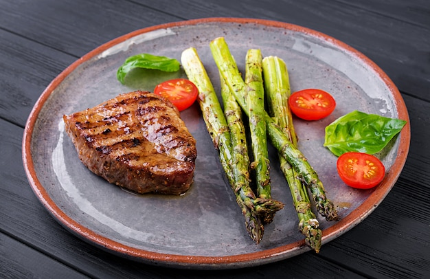Barbecue grilled beef steak meat with asparagus and tomato