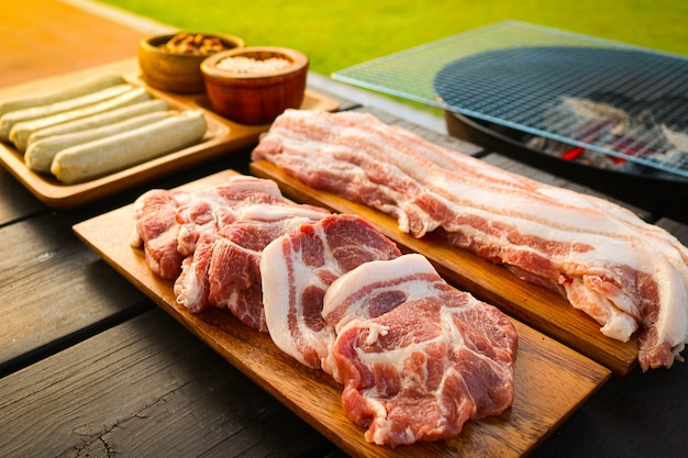 Barbecue is being baked outdoors on a grill