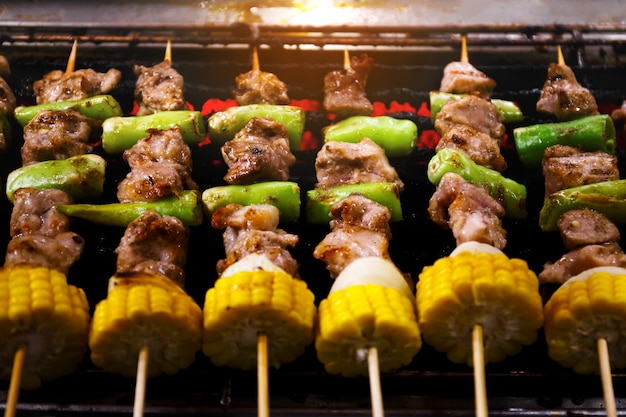 Barbecue skewers meat kebabs with corn and vegetables