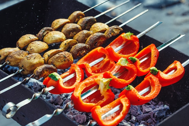 Barbecue skewers with grilled bell peppers and champignon mushroom kebab