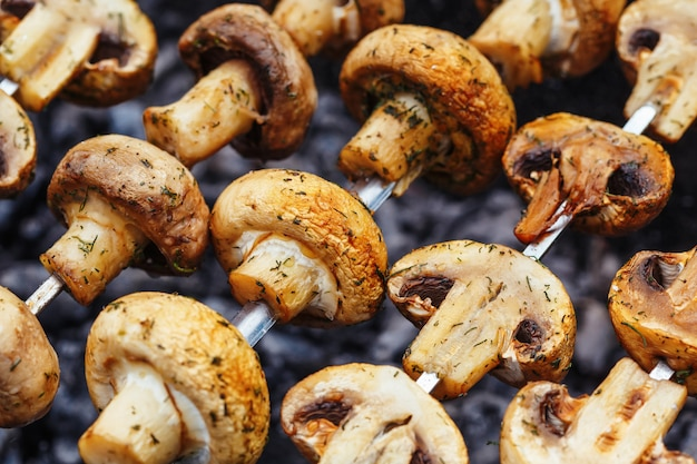 Barbecue skewers with grilled champignon mushroom kebab in a brazier