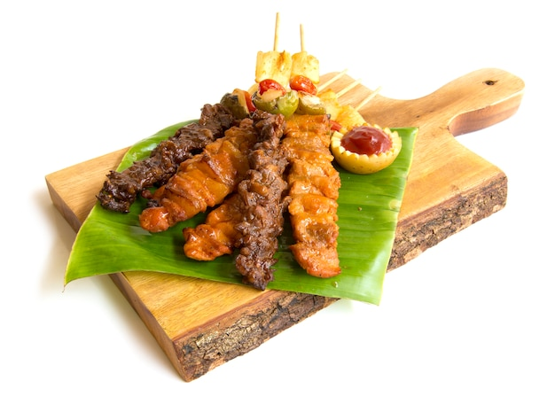 Barbecue stick with juicy grill with bbq sauce fusion food style on chopped wood