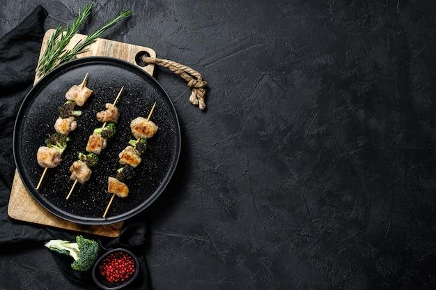 Barbecued chicken breast skewers.