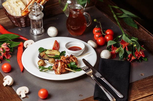 Barbecued marinated turkey or chicken meat shish kebab skewers with ketchup sauce