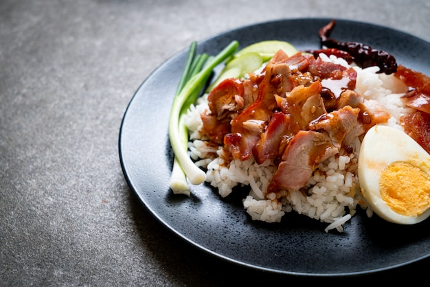 Barbecued red pork in sauce on topped rice