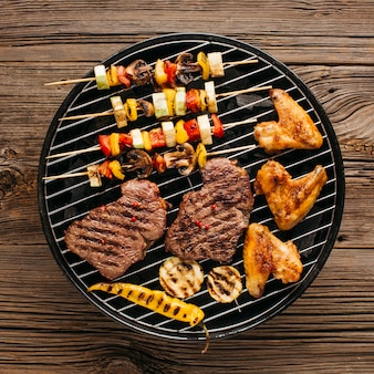 Barbecuing assortment of meat with sausages and vegetable