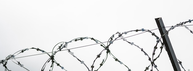 Barbed wire on country border. barbwire on fence for prohibition