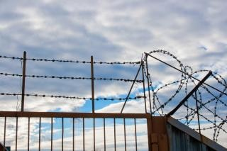 Barbed wire fence  caution