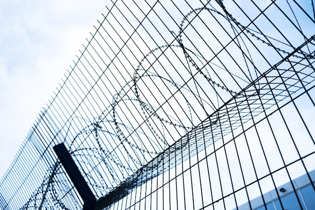 Barbed wire mesh fence. close-up. passage is limited