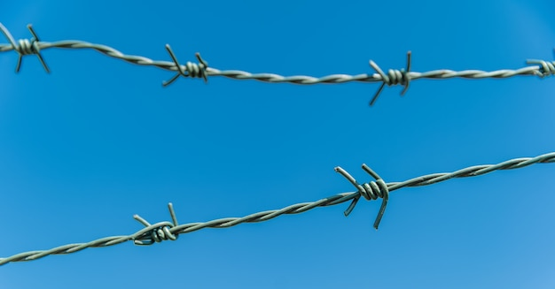 Barbed wire with blue sky in the background