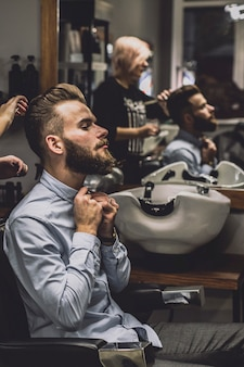 Barber and client at mirror