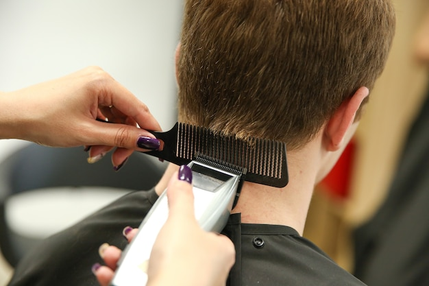 Barber cutting the hair of a client