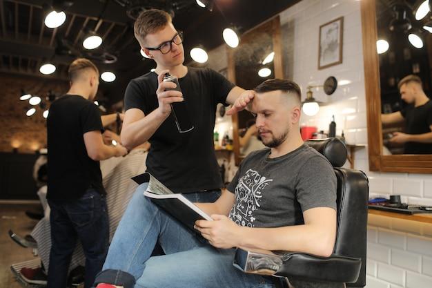 Barber fixing haircut of a man