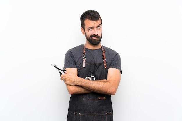 Barber man in an apron feeling upset