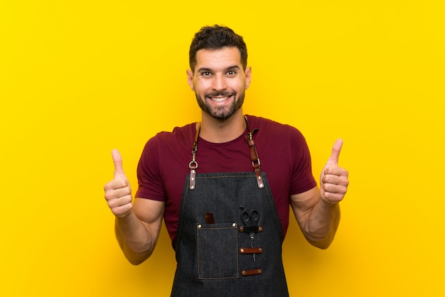 Barber man in an apron giving a thumbs up gesture