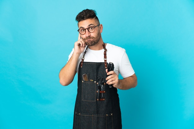 Barber man in an apron thinking an idea