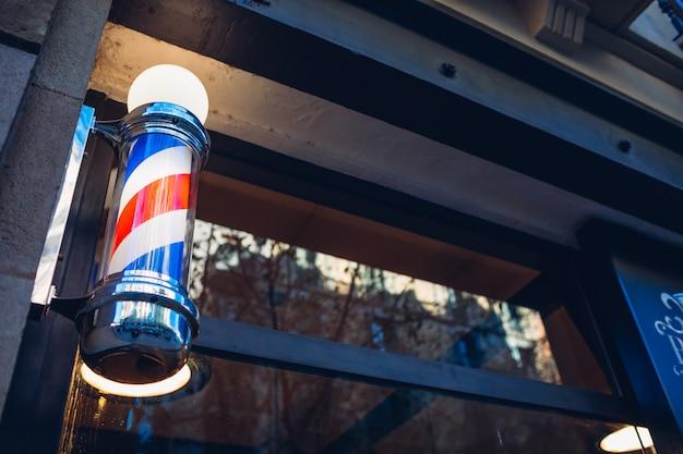 Barber's pole on a barbershop wall