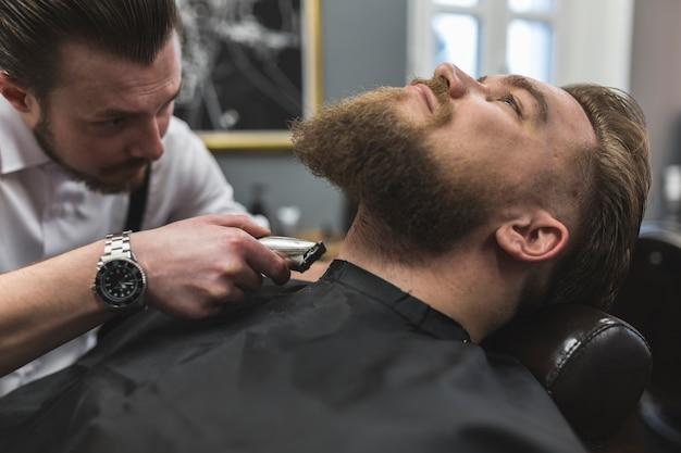 Barber shaving neck of customer