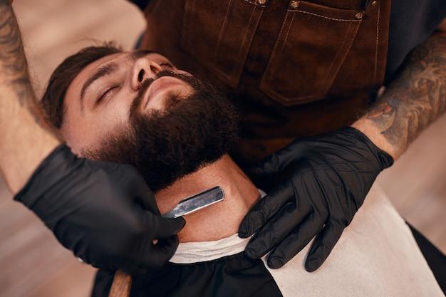 Barber shaving neck of a customer