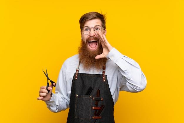 Barber with long beard in an apron shouting with mouth wide open
