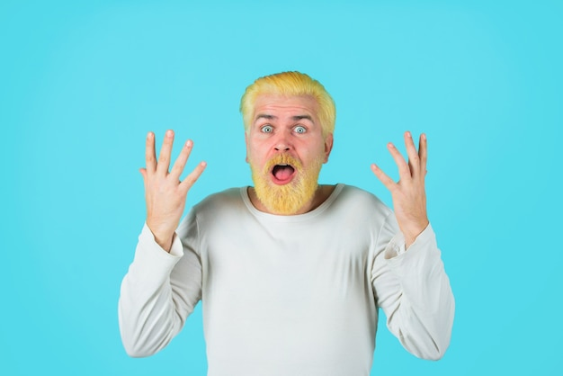 Barbershop concept surprised man with bleached hair man with bleached hair and beard coloring of