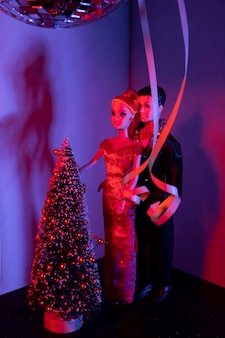 Barbie and ken dolls with decorated tree