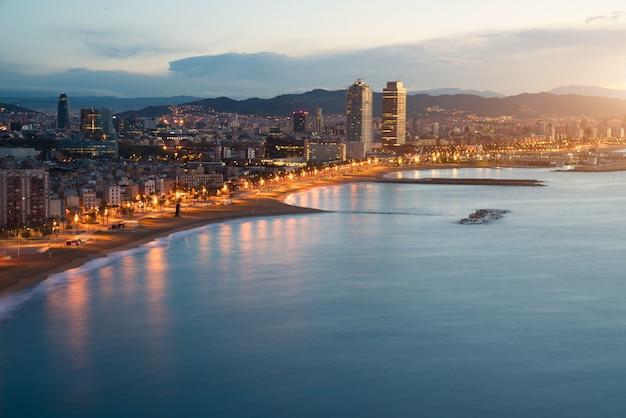 Barcelona beach in summer night along seaside in barcelona, spain. mediterranean sea in sp